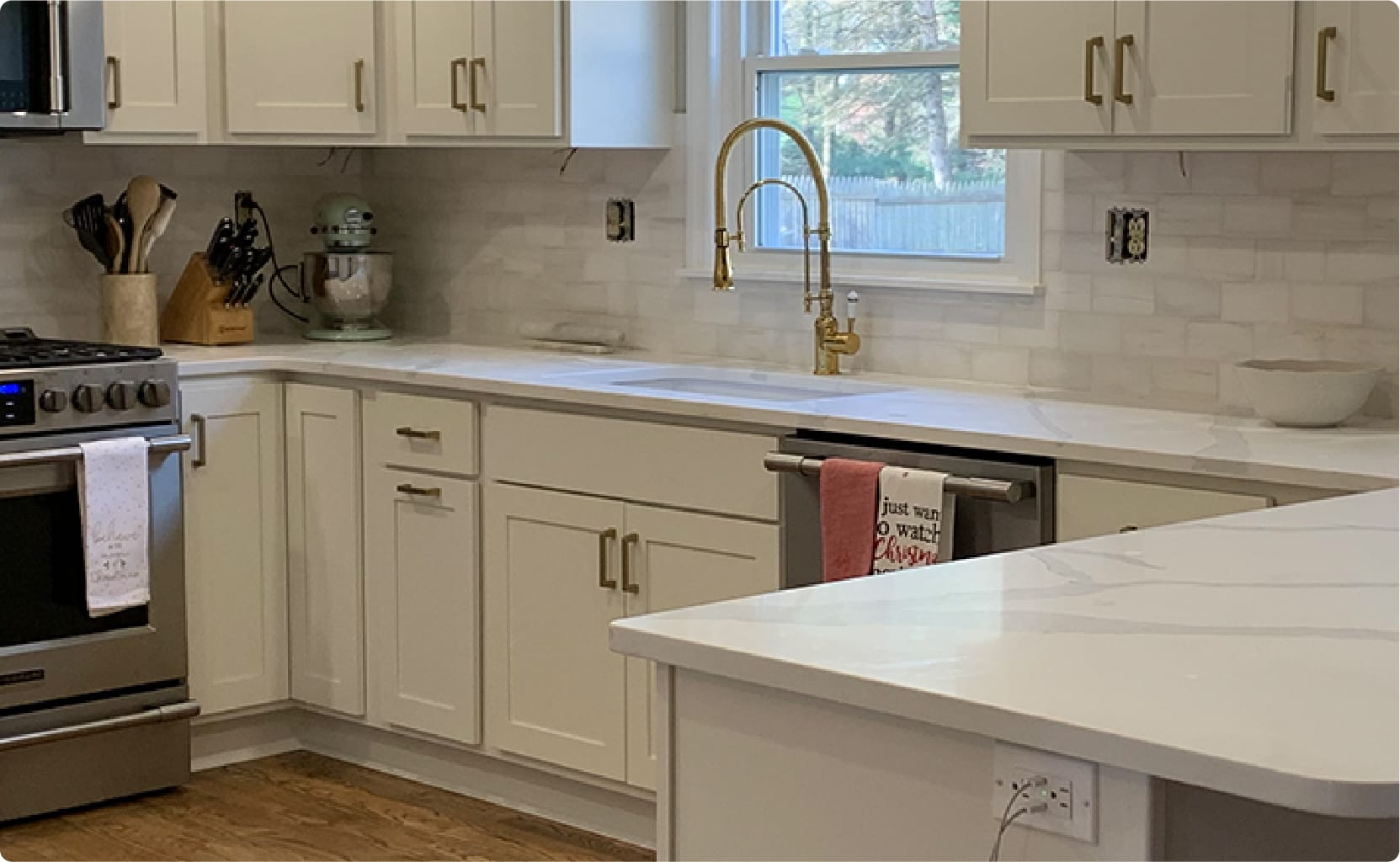 white cabinets in a kitchen with a hardwood floor